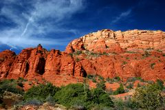 Sedona Red Rocks. Red rocks taken from Chapel of the Holy Cross, with a cross in the shape of the clouds Royalty Free Stock Photography
