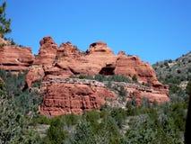 Sedona Sedimentary Landform. Photograph of the beautiful landscape in Sedona, Arizona. Visible sedimentary layers of rock. Great contrast between the blue sky stock photo