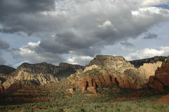 Sedona Sky. Arizona landscape with red rocks and cloud cover and sunlight Royalty Free Stock Photos