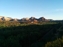Sedona at sunset with deep shadows. And vivid rock formations and distant houses royalty free stock images