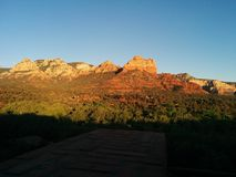 Sedona at sunset with vivid rock formations and deep shadows. With distant houses stock photo