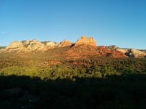 Sedona at sunset with vivid rock formations and deep shadows. With distant houses stock photos