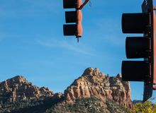Sedona traffic lights. Uptown Sedona, Arizona, with Camel Rock in the background Royalty Free Stock Image