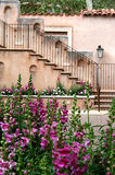 Sedona villa. This is a portion of a wall in Tlaquepaque in Sedona, Arizona with flowers in the front of it Stock Photography