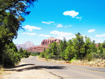 Sedona Wild Red Rocks And The Road Travel. Sedona beautiful view of sky rocks and scenery clear blue sky Stock Images