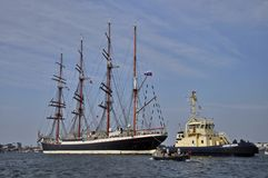 The Sedov tall ship on the Ij river. Port Amsterdam, Amsterdam, the Netherlands - August 23, 2015: The Sedov tall ship (Russia) cruising on the Ij river on the Stock Photography
