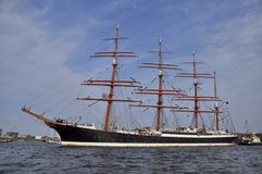 The Sedov under the blue sky. Port Ijhaven, Amsterdam, the Netherlands - August 23, 2015: The Sedov tall ship (Russia) cruising on the last day of the SAIL 2015 Stock Image