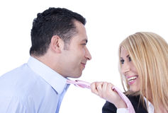 Seducing the man. A young beautiful blond is teasing her partner to seduce him Royalty Free Stock Images