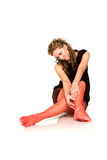 Seducing young girl in red stockings Stock Image