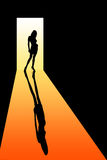 Seduction. Silhouette of a seductive lady in an open door Royalty Free Stock Images