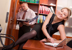 Seduction at workplace Stock Photography