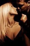 Seductive. Young couple in love, studio dark Royalty Free Stock Photos