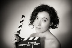 Seductive actress with clapperboard, vintage black and white clo Stock Photo