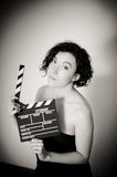 Seductive actress with clapperboard, vintage black and white por Royalty Free Stock Photo