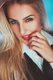 Seductive adult blonde woman looking at camera Royalty Free Stock Photography