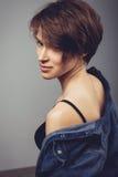 Seductive beautiful woman in jean shirt Stock Image