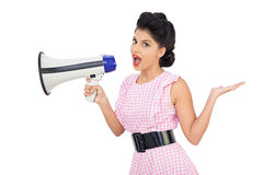 Seductive black hair model using a megaphone Stock Image