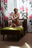 Seductive blond in armchair Royalty Free Stock Photo