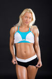 Seductive blond athlete royalty free stock photography