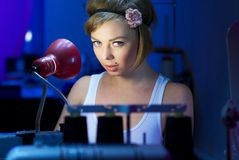 Seductive blond sewing in her workshop Stock Photography