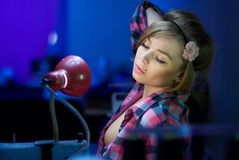Seductive blond sewing in her workshop Stock Images