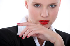 Seductive blond wearing lip-stick. Seductive blond wearing red lip-stick and nail varnish Royalty Free Stock Image