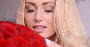 Seductive Blond Woman Behind Red Rose Bouquet stock video footage