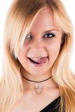 Seductive blond woman licking lips. Beautiful seductive blond woman licking lips Royalty Free Stock Photography