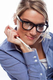 Seductive blonde businesswoman wearing glasses Stock Photos