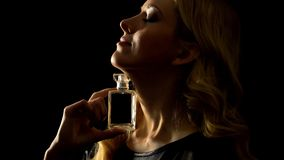 Seductive Blonde Female Showing Luxury Perfume, Sexy Scent, Pheromones Effect Royalty Free Stock Images