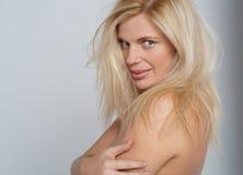 Seductive blonde posing topless. Beat the heat. Hot seductive blonde posing topless Stock Photography