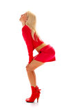 Seductive blonde in red Stock Images