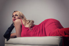 Seductive blonde woman in red dress Stock Image