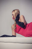 Seductive blonde woman in red dress Royalty Free Stock Image