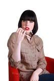 Seductive brunette. Sat on a deisgner chair Stock Photography