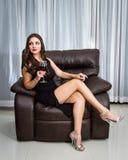 Seductive brunette in a black dress Royalty Free Stock Image