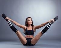Seductive brunette doing stretching exercises Stock Image