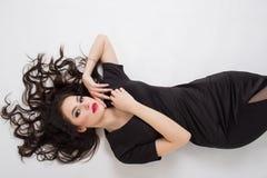 Seductive brunette girl. Seductive brunette in a black dress Royalty Free Stock Photos