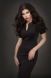Seductive brunette girl. Seductive brunette in a black dress Stock Photos