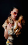 Seductive brunette holding fur Stock Image