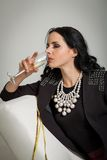 Seductive brunette holding a glass of champagne Stock Photo