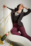 Seductive brunette holding a glass of champagne Royalty Free Stock Images