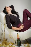 Seductive brunette holding a glass of champagne Stock Photography