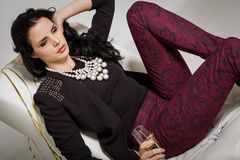 Seductive brunette holding a glass of champagne Stock Photos