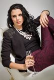 Seductive brunette holding a glass of champagne Royalty Free Stock Image