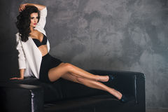 Seductive brunette posing in studio Royalty Free Stock Photography