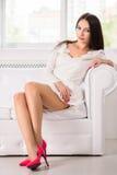 Seductive brunette wearing white dress Stock Photo
