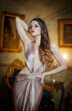Seductive brunette woman in luxury manor, vintage style Royalty Free Stock Image