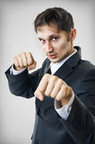 Seductive businessman boxing to the shot Stock Image
