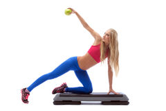 Seductive cute model exercising on stepper. In studio Royalty Free Stock Photos